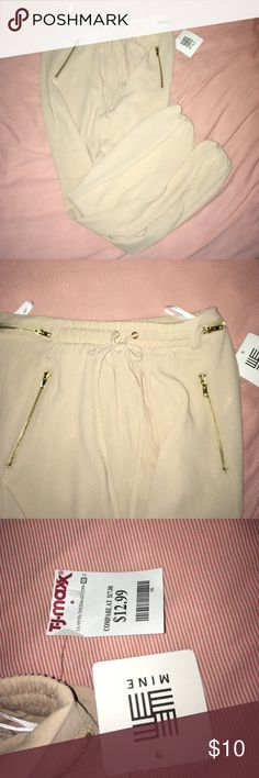 😸CREAMY/TAN PANTS These pants are cute and light. They feature a stretchy waistband and stretchy elastic around the ankles. All zippers work if needed. Waistband can tie smaller if needed. In perfect condition, only worn once to try on. Smoke free home. Comment with any questions and I'll answer ASAP! ☺️ make an offer! mine Pants
