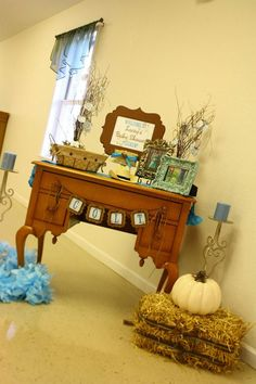Western baby shower - like the branches and old frames.