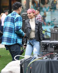 Pink lady! Richie's fuchsia pink hair popped against her black leather jacket and tight je...