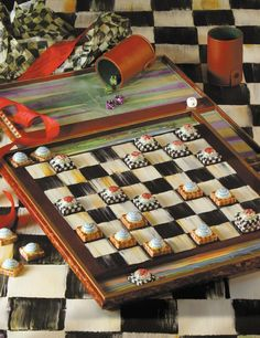 MacKenzie Childs ... Checkers anyone? paint  on top of outdoor table