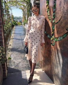 Olivia Culpo wears the Autumn 2017 Starling Dress, arriving in stores and online in June.
