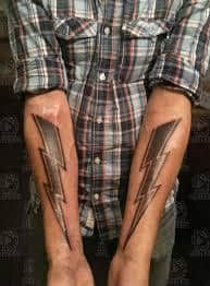What does lightning bolt tattoo mean? We have lightning bolt tattoo ideas, designs, symbolism and we explain the meaning behind the tattoo. Arm Tattoo, Body Art Tattoos, Tribal Tattoos, Cool Tattoos, Tatoos, Lineman Tattoo, Lightning Bolt Tattoo, Hybrid Moments, Body Modifications