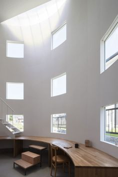 House in Hikone is a minimalist house located in Shiga, Japan, designed by Tato Architects. The two-story residence features double-height spaces, curved on each end with a surface that follows the wall. (10)