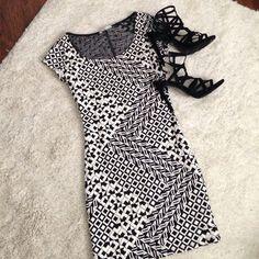 Black & White Dress! Never worn. Mini dress. Veryyyyy fitting/runs small. Black & white design all over dress. Short sleeves. Charlotte Russe Dresses Mini
