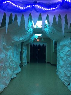 Icicles can be cut and then hung from sheet of white butcher paper