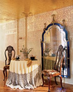 Love how the oversize mirror, wall stencil & chair backs echo one another + golden ceiling. Florence de Dampierre: June 2011