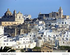 "Ostuni town near Brindisi, Italy - This is a beautiful hill town also known as ""The White City"". The town's whitewashed houses and narrow alleys are ideal to explore the beauty of this Italian gem. There are many cafes to relax, enjoy the atmosphere and admire the architecture of the town inhabited since the Stone Age."