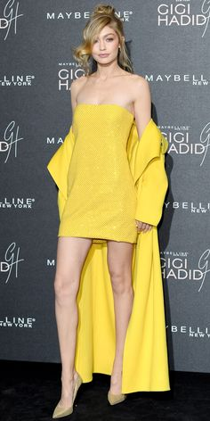 Excuse us while we scream. Gigi Hadid celebrated her collaboration with Maybelline in the chicest all yellow everything look. The model flaunted her mile-long legs in a sequin mini paired with an oversized coat in matching yellow. A pair of glitter pumps completed the head-turning look.