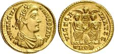 Magnus Maximus (383-388). Solidus, 4.42 g, Treveri. D N MAG MA – XIMVS P F AVG. Rosette-diademed, draped, cuirassed bust right. / VICTOR – IA AVGG. Two emperors seated facing, together holding a globe with their hands; between them in background, bust of Victory facing with outspread wings; between them at bottom, a palm. In exergue, TROB. RIC 77b; Cohen 9.