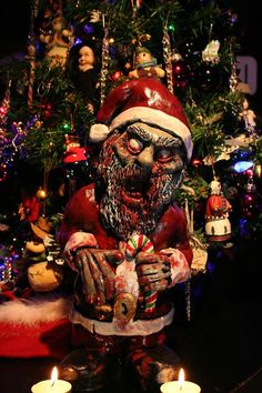 """Zombie Santa Corpse - Zombie Christmas Ornament / Decoration by RevenantFX on Etsy"" (See all of their holiday themed zombie lawn gnomes here: https://www.etsy.com/shop/RevenantFX?section_id=14646717)"