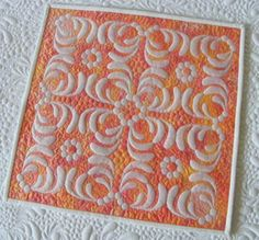 This handmade shadow trapunto quilt measures 15.5 inches square and is perfect for a wall or frame.