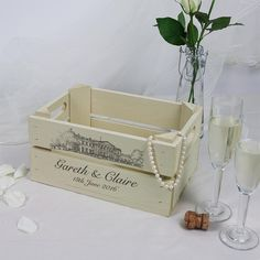 Small personalised wooden apple crate with an illustration of your wedding venue, the perfect personalised wedding gift.