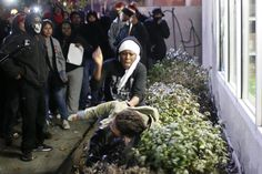 A protester confronts another protester (bottom), who was attempting to protect a convenience store, during a demonstration following the grand jury decision in the shooting of Michael Brown, in Oakland, California November 26, 2014.