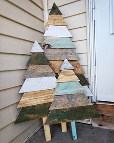 If you're eco-conscious & want it to reflect in your Christmas decorations, here's a list of best recycled Christmas tree ideas you can try. Recycled Christmas Tree, Wooden Christmas Decorations, Christmas Wood Crafts, Outdoor Christmas, Christmas Art, Christmas Projects, Wooden Xmas Trees, Driftwood Christmas Tree, Pallet Wood Christmas Tree