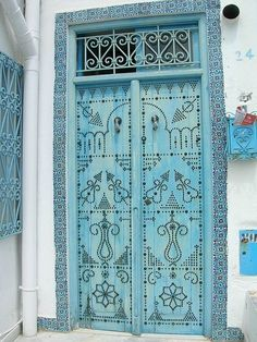 Arabic door in pretty shades of aqua blue | Learn Arabic the fun way http://eurotalk.com/en/store/learn/arabicegyptian