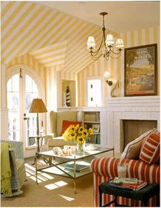 yellow striped room with fireplace
