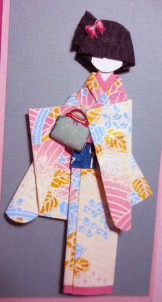 """Materials: Thai and Japanese card stocks; washi tape; Thai """"saa"""" paper; yuzen washi (kimono and obi); origami paper; bag and bow 3-D stickers; Japanese """"sakura"""" sticker.  Card dimensions: 14.7 cm x 10.5 cm Doll height: 8.6 cm"""