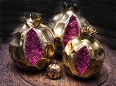 A beautifully handcrafted pomegranate objects , with semi precious stones … Made out of bronze, plated by 18-24 karat gold...Oxidized to have a unique character…
