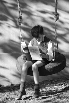 Sitting on a tire swing, reading... no video games. ~