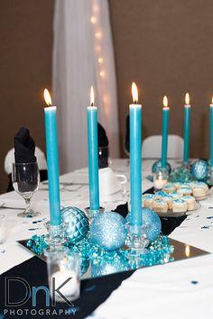 Light blue candle centerpieces.