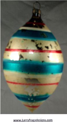 GERMAN FREE BLOWN ORNAMENT Dimensions: 3 1/2'' Description: German free blown ornament, red white and blue stripes