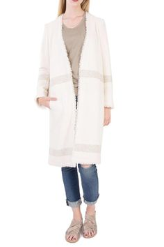 Feel like you stepped off the runway in the long boucle jacket. Rustic fabric in a cotton blend. Contrast ringer and frayed edges; front concealed hook fastening; partial fully lined; side slit pockets.   Frayed Edges Coat by Hoss Intropia. Clothing Portland, Oregon