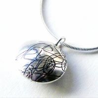 Hand made silver pendant by Claire Williams available at Franny & Filer jewellery shop in Chorlton - www.frannyandfiler.com - £52