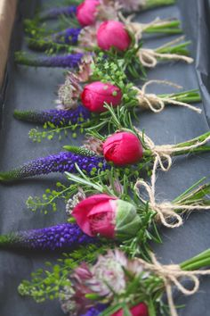 Ranunculus and veronica cluster button holes