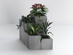 Ciekawa aranżacja wykonana z czterech antracytowych donic o różnej wysokości. Donice wykonane przez cenioną markę Bettoni stworzone zostały z betonu architektonicznego o średniej porowatości.