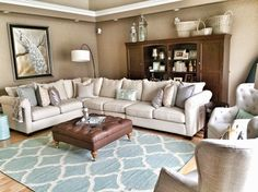 Tie in the carpet color by using plenty of same colored accessories at HomeGoods!! Garden stool, pillows and candles in aqua make for one pretty room! #rug #aqua #sponsored