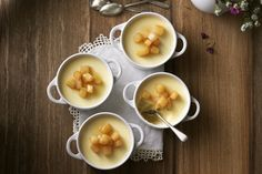 The custard in these maple pots de crème is made even sweeter by adding a buttery pear topping. Your guests will love this sophisticated dessert at your next special occasion. Photo by James Tse.