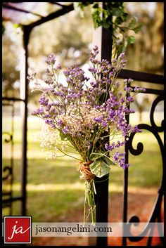 flowers tied to ceremony arch