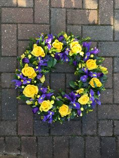 Yellow and purple blue funeral tribute wreath of roses, freesias, iris, lisianthus and thistle Purple Flower Arrangements, Funeral Floral Arrangements, Flower Wreath Funeral, Funeral Flowers, Flower Box Gift, Flower Boxes, Cemetery Decorations, Purple Wreath, Funeral Tributes