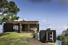 Completed in 2015 in Whangarei Heads, New Zealand. Images by Patrick Reynolds. A holiday house for primarily summer use with a boatshed /garage. The house will not be used as a permanent residence.  Concept: