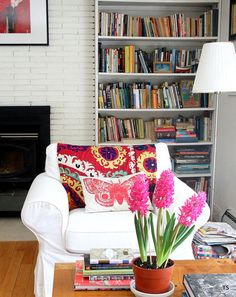 Pops of color added to an eclectic living room by Tamar Schechner