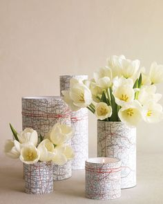 Map-Covered Vases Cut charts to fit around cylinders of various heights, then attach them with double-stick tape and fill each with flowers or a candle.& The Details: Jamali Floral & Garden Supplies glass cylinders. Next: Map Picture Frames Unique Centerpieces, Wedding Centerpieces, Wedding Decorations, Travel Centerpieces, Centerpiece Ideas, Map Decorations, Shower Centerpieces, Candle Centerpieces, Martha Stewart Weddings