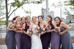 Cincinnati wedding. Different shades of bridesmaids dresses with the most amazing bouquets ever!