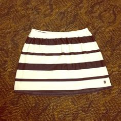 "Bundle for $5 Nike Workout Skirt Bundle 3 for $15, all items $8 and under Nike Workout Skirt size M. Cute skirt for lounging. The shorts underneath have been cut out. This did not affect the waist band. Elastic waist stretches up to 19"", appx 16"" long, 23"" across the bottom flat. Great stretch, 88% poly, 12% stretch. MC/021815 Nike Skirts"