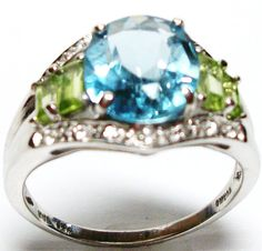 Sky blue topaz & peridot accent cocktail ring s by Michaelangelas