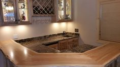 Coliseum granite with a chipped edge and an under mount sink