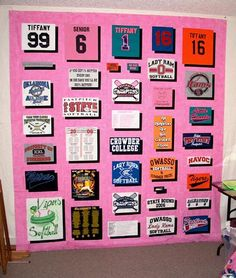T-shirt quilt.  I love how the black stained glass style of quilting makes the shirts pop on the pink background.