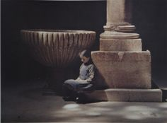 History of photography Autochrome, girl sitting by pillar in sunlight.Autochrome, Fernand Colville's Vault of San Zeno de Maggiore, Verona, Italy. Albert Kahn's Archive of the Planet (The Wonderful World of Albert Kahn
