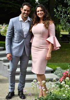 Blooming romance: Kelly Brook, 37, and Jeremy Parisi, 32, put on a cosy display at Hampton Court Flower Show in East Molesey, Surrey, on Monday