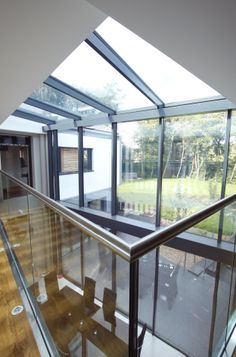 an internal view of the double height glass link and glass balustrades around the walkway www.iqglassuk.com