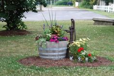 A wood barrel is a great way to add country charm to any garden or porch...
