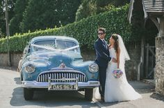 groom in shades, bride looking lovely & a vintage wedding car / Mckinley-Rodgers Photography