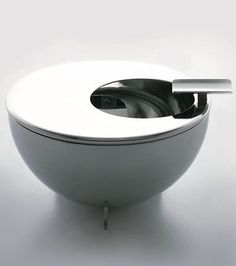 Marianne Brandt Ashtray  Marianne Brandt Designed 1926  Produced by Alessi  Stainless steel with removable lid and holder  H. 2 in. D. 4¾ in.