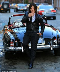 Men's Fitness Shoot - NYC Smooth: The actorlooked deep in thought as he rubbed his whiskered chin while resting against the exquisite car's exterior
