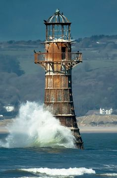 Whiteford Point #Lighthouse, built in 1865, is the only cast iron lighthouse surrounded by the sea in the #UK. It stands a mile off-shore, just above the low water mark on the north-west tip of the Gower Peninsula. http://dennisharper.lnf.com/