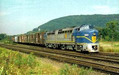 """Two Baldwin RF16 """"Sharknose"""" Diesel locomotives stand out in their flashy Delaware and Hudson livery. Both of these units were acquired by the D&H from the Monongahela Railway, the Monongahela had acquired them from the New York Central."""